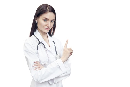 Portrait of a handsome doctor pointing his index finger upwards, isolated on white background