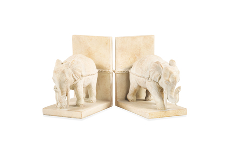 clay figurine of two elephants against a wall on a stand isolated on white background Фото со стока