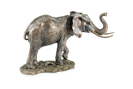 bronze figurine of an elephant on a stand with a raised trunk isolated on white background