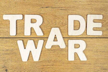 phrase - trade war, laid out in wooden letters on an old wooden table
