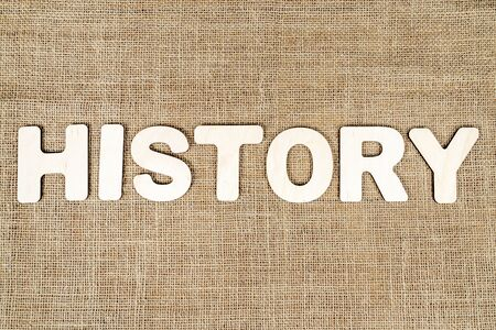 word history laid out from wooden letters on the old sacking