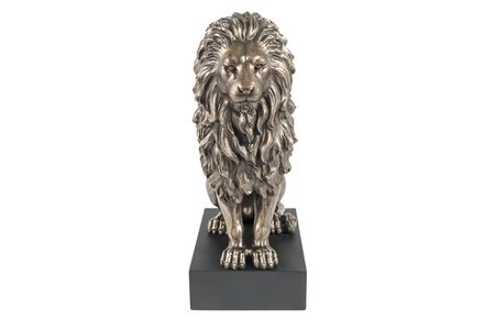 bronze statuette of a sitting lion on a black stand isolated on white background