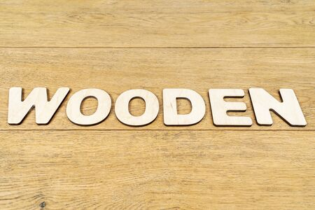 wooden word made from wooden letters on an old table Banco de Imagens