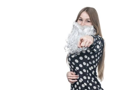 beautiful woman with santa beard points a finger at camera isolated on white background