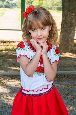 portrait of a beautiful little preschool girl wearing an embroidered shirt - national Ukrainian costume