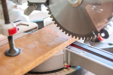 circular saw blade close to the board is ready for cutting Standard-Bild