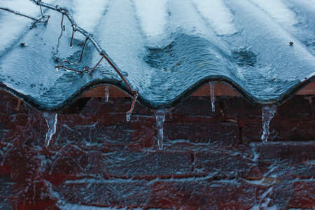 frost winter: The winter ice rooftop icicles Frost snow