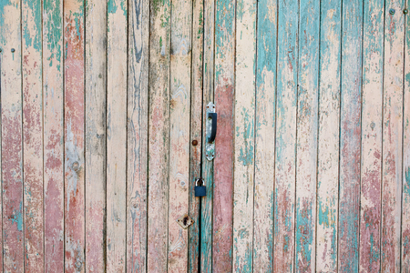 Fragment of the old and dilapidated doors. Wooden vertical texture of turquoise Colors, shabby wooden surface. Old texture for antique background Old texture for antique background