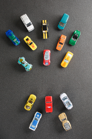 Colorful automotive toys. The apartment was lying, on a gray background