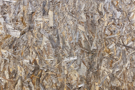 new wood chipboard background, texture shavings, sawdust