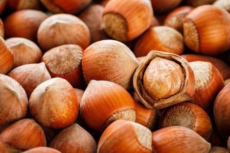 Hazelnuts. Stack of hazelnuts. Food background. Hazelnut background. Hazelnuts in shells background, peeled nut Archivio Fotografico
