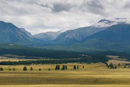 Scenic view of the snow-covered North-Chuya range in the Altai mountains in the summer, Siberia, Russia. Imagens