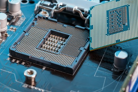 Electronic engineer of computer technology. Maintenance computer cpu hardware upgrade of motherboard component. Pc repair, technician and industry support concept. Banque d'images