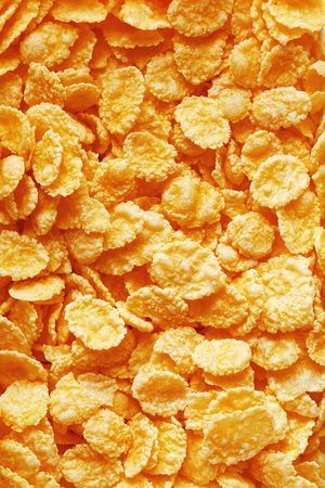 Golden cornflakes background and texture. View from above. cornflakes healthy breakfast. Close-up
