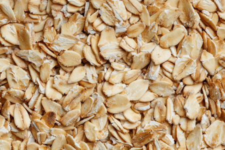 Golden cereal muesli, background and texture. Oatmeal grains. Healthy breakfast Top view. Close-up. macro