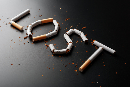 The inscription LOST from cigarettes on a black background. Stop smoking. The concept of smoking kills. Motivation inscription to quit smoking, unhealthy habit. Smoking as a deadly habit, nicotine poison, cancer and smoking Фото со стока