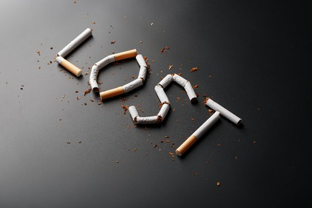 The inscription LOST from cigarettes on a black background. Stop smoking. The concept of smoking kills. Motivation inscription to quit smoking, unhealthy habit. Smoking as a deadly habit, nicotine poison, cancer and smoking 版權商用圖片