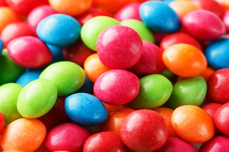 Rainbow colors of multicolored candies close-up, texture and repetition of dragee. Background 版權商用圖片