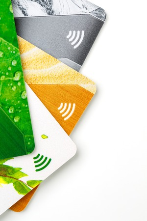 Credit cards with contactless payment. Pile of credit cards on white isolated background. Selective focus and close-up.