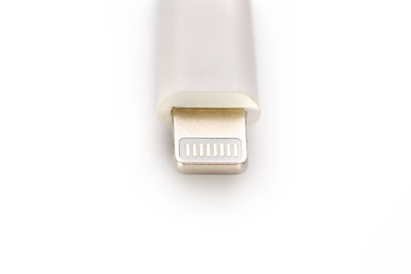 Connector lightning on a white background. This is a proprietary connector used to connect mobile devices to well-known host computers.