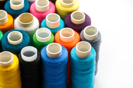 Colorful spools of sewing thread. Colored thread for sewing Imagens