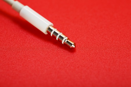 White connector auxiliary white cable on a red background