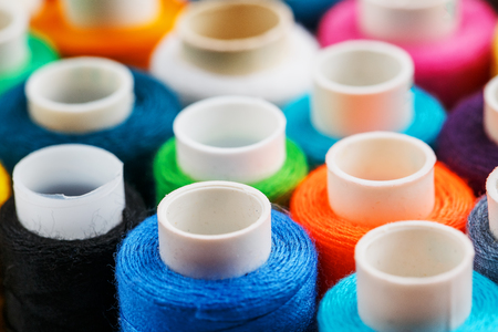 Colorful spools of sewing thread. Colored thread for sewing. Texture background