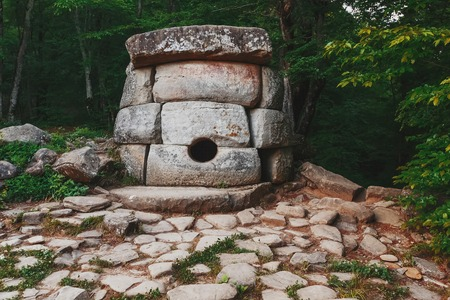 Ancient round compound dolmen in the valley of the river Jean, Monument of archeology megalithic structure. Historical value of the 7 15th centuries. Russia, southeast of Gelendzhik, Renaissance layer.