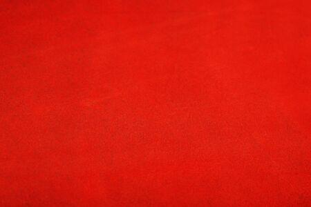 Die Textur der Haut ist rot als abstrakter Hintergrund, schönes Texturmuster Vollbild, Draufsicht
