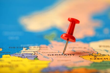 The red button indicates the location and coordinates of the destination on the map of the country of Germany. Concert button indicates the country and city of Germany Фото со стока - 128311817