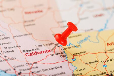 Red clerical needle on a map of USA, California and Sacramento Capital. Close up map of California with red tack, US map pin
