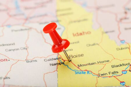 Red clerical needle on a map of USA, Idaho and the capital Boise. Closeup Map Idaho with Red Tack, US map pin