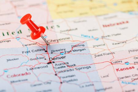 Red clerical needle on a map of USA, Wyoming and the capital Cheyenne. Close up map of wyoming with red tack, US map pin United States