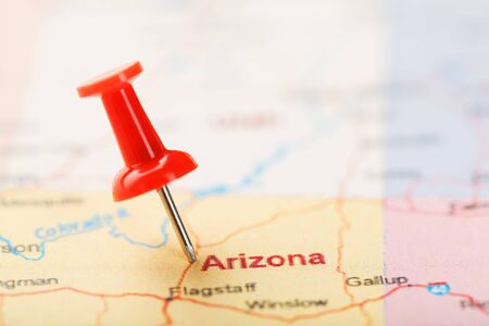 Red clerical needle on a map of USA, Arizona and the capital Phoenix. Closeup Map Arizona with Red Tack, United States map pin