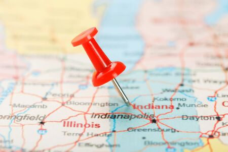 Red clerical needle on a map of USA, Indiana and the capital Indianapolis. Close up map of Page protected with pending changes Indiana with red tack