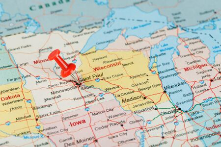 Red clerical needle on a map of USA, Minnesota and the capital Saint Paul. Close up map of Minnesota with red tack
