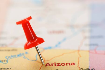 Red clerical needle on a map of USA, Arizona and the capital Phoenix. Closeup Map Arizona with Red Tack