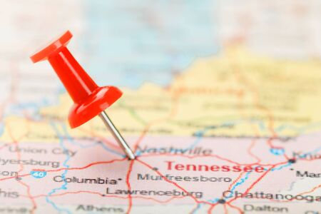 Red clerical needle on a map of USA, South Tennessee and the capital Nashville. Close up map of South Tennessee with red tack, United States map pin USA