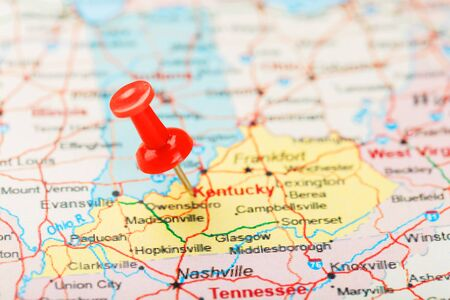 Red clerical needle on a map of USA, South Kentucky and the capital Frankfort. Close up map of South Kentucky with red tack, United States map pin USA