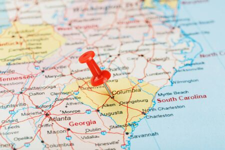 Red clerical needle on a map of USA, South South Carolina and the capital Columbia. Close up map of South South Carolina with red tack, United States map pin USA