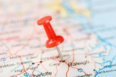Red clerical needle on a map of USA, South North Carolina and the capital Raleigh. Close up map of South North Carolina with red tack, United States map pin USA