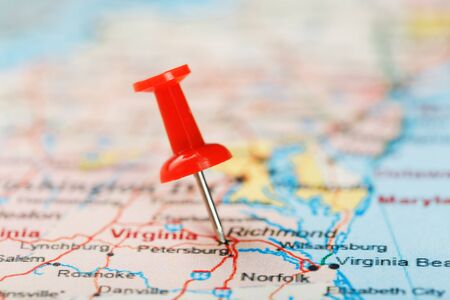 Red clerical needle on a map of USA, South Virginia and the capital Richmond. Close up map of South Virginia with red tack, United States map pin USA