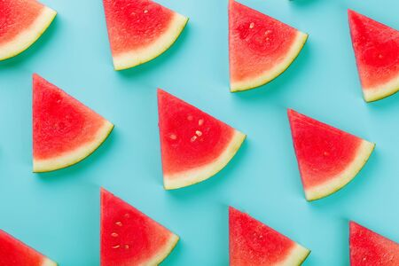 Summer drawing of red fruit watermelon slices on a light blue background. Minimal summer concept. Fashionable Sun Color 版權商用圖片