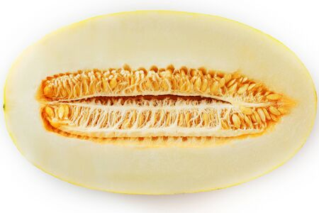 Yellow torpedo melon on a white background, divided into slices and slices. Seeds and pulp. Fragrant and healthy fruit.