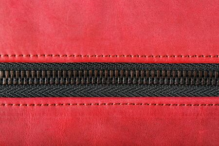 Bag for cosmetics and jewelry made of genuine red leather, on a dark background. Handwork, View from above Archivio Fotografico - 130035758