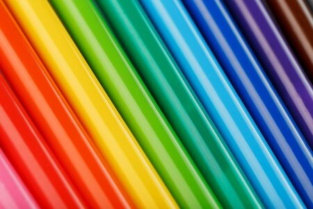 Multi-colored felt-tip pens, markers on a white isolated background, Rainbow colors close-up, macro.