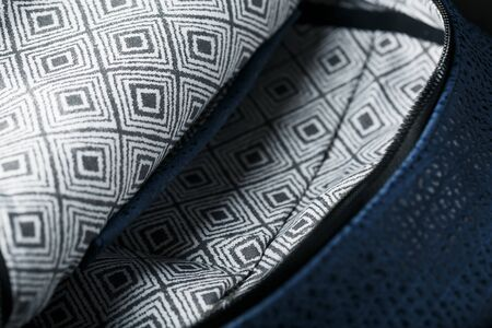Close-up inside pockets, elements of a blue backpack made of genuine leather on a dark background, handmade. Macro 免版税图像