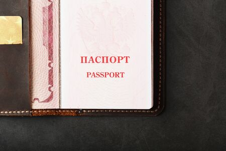 Open Passport Leather Cover with Gold Credit Card. Russian Federation, handwork close-up.