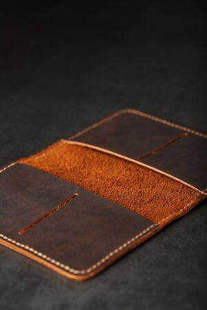 Open Dark Brown Leather Passport Cover. Genuine leather, handmade. Close up stitching, View from above Фото со стока