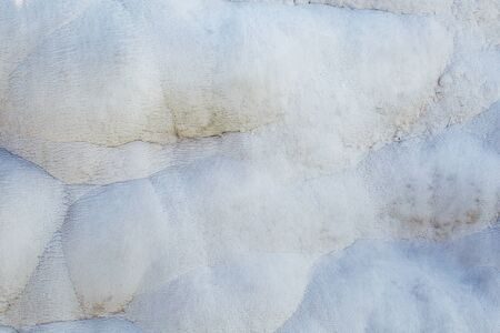 The texture of light calcium carbonate in full screen as a substrate, background. Texture of travertine, thermal spring of the city of Pamukkale in Turkey. Stok Fotoğraf